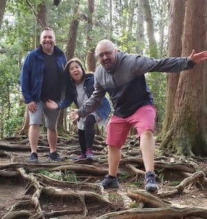 Board members of Reiki Centers of America, Brian Brunius, Diane Domondon, and Christopher Tellez, on top of Mount Kurama in Kyoto, Japan