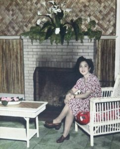 Photo of Hawayo Takata seated at the fireplace in 1951